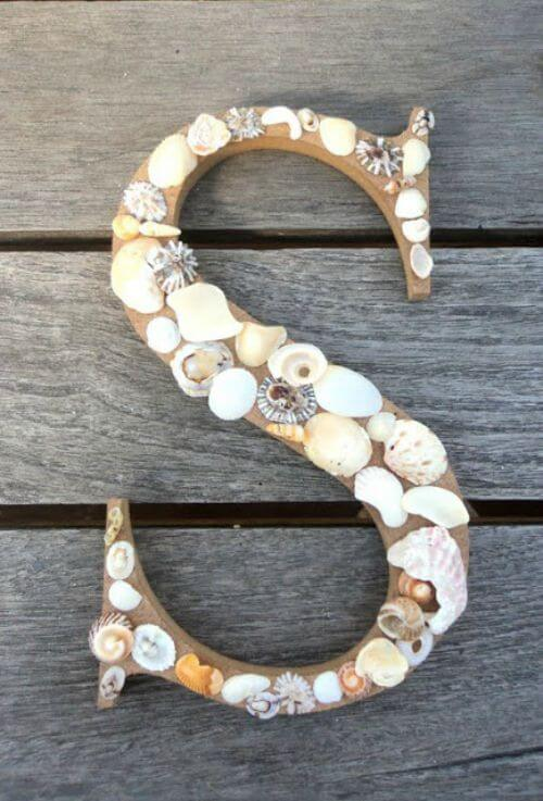 seashells on a wooden letter